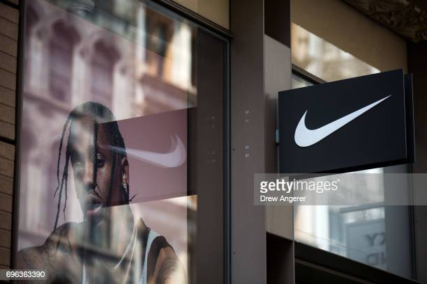 The Nike 'swoosh' logo is displayed outside of the Nike SoHo store, June 15, 2017 in New York City. Nike announced plans on Thursday to cut about 2...