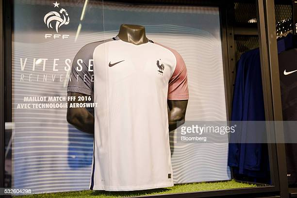 The Nike Swoosh logo sits on an official French national football team jersey inside the Nike Inc sports apparel store in Paris France on Thursday...