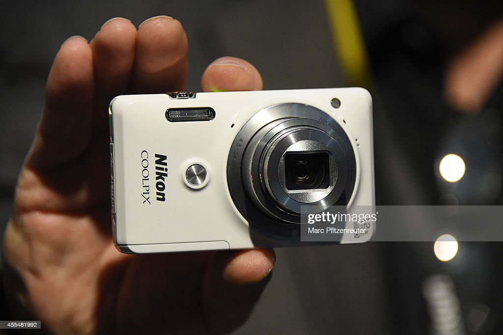 The Nikon Coolpix 12x wide Full HD is presented at the Photokina 2014 trade fair on September 15, 2014 in Cologne, Germany. Photokina is the world's largest trade fair for cameras and photographic equipment.