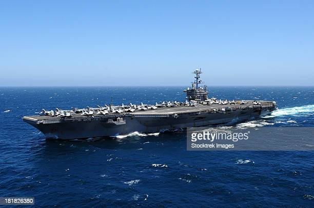 The Nimitz-class aircraft carrier USS John C. Stennis underway in the Pacific Ocean.