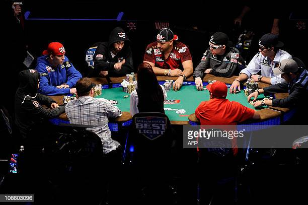 The nine final players in the 2010 World Series of Poker Main Event play a hand at the start of competition in Las Vegas Nevada November 06 2010 The...