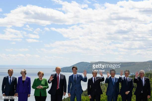 The nine leaders pose for the media during the Family photo on the first day of the G7 Summit on 8 June 2018 in La Malbaie Canada Canada will host...