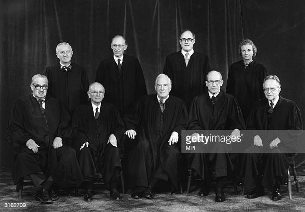 The nine members of the Supreme Court of the United States of America John Paul Stevens Lewis F Powell Jr William Rehnquist and Sandra Day O'Connor...