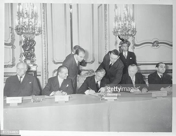 The Nine Power Act is signed Left to right J Beck Luxembourg Gaetano Martino Italy Anthony Eden Britain Konrad Adenauer Germany and MendesFrance...