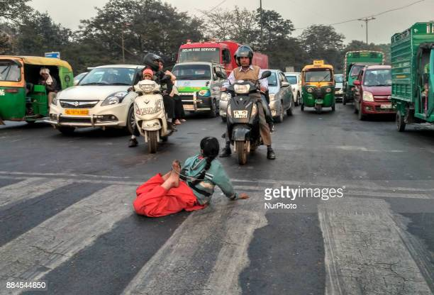 The nineyearold girl performs a stunt at Feroz Shah Kotla when traffic was halted at the redlight to impress many passersby in a bid to earn money in...