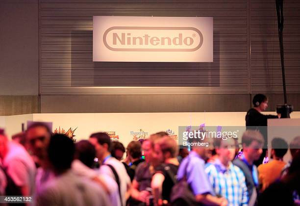 ddc6212ed3ef The Nintendo Co logo sits on display as visitors attend the Gamescom video  games trade fair