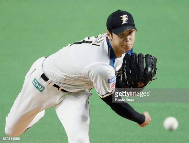 The Nippon Ham Fighters' Shohei Otani throws in a file photo taken in Sapporo Hokkaido on Oct 4 2017 Otani is expected to move to the major leagues...
