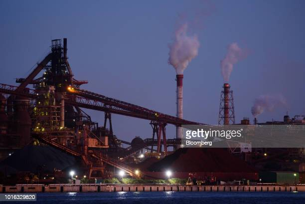 The Nippon Steel Sumitomo Metal Corp Nagoya Works facility stands at dusk in Tokai Japan on Tuesday July 31 2018 Japan is scheduled to release trade...
