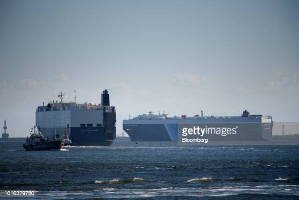 The Nippon Yusen KK Daedalus Leader vehicle carrier right and the Positive Pioneer vehicle carrier sail in Nagoya Japan on Tuesday July 31 2018 Japan...
