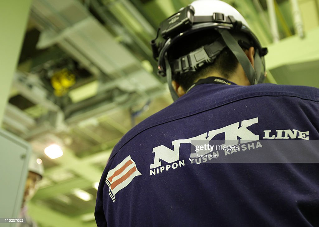 The Nippon Yusen K.K. logo is seen on an uniform of an employee during a media tour for the company's car transporter ship, Auriga Leader, at Mitsubishi Heavy Industries Ltd.'s Honmoku plant in Yokohama city, Kanagawa prefecture, Japan, on Wednesday, June 15, 2011. Nippon Yusen K.K. is Japan's largest shipping line. Photographer: Tomohiro Ohsumi/Bloomberg via Getty Images