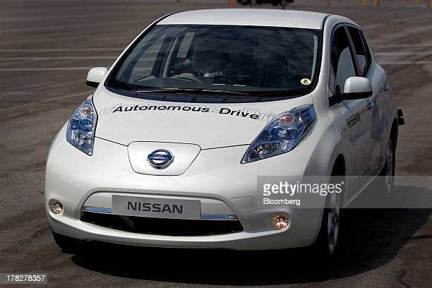 The Nissan Autonomous Drive Leaf electric vehicle sits on a test track during the Nissan Motor Co 360 event in Irvine California US on Tuesday Aug 27...