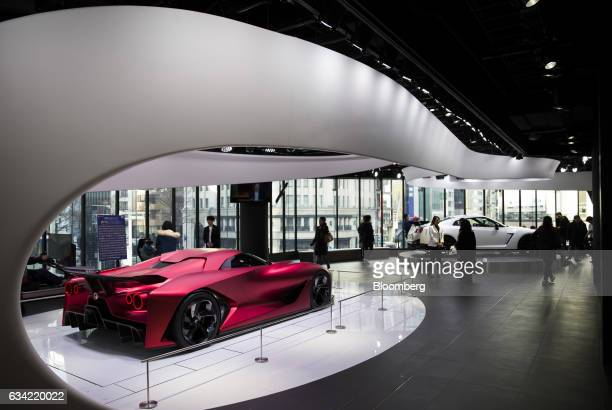 The Nissan Concept 2020 Vision Gran Turismo concept vehicle left sits displayed at Nissan Motor Co's Nissan Crossing showroom in the Ginza district...