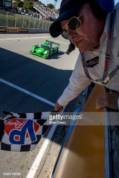 The Nissan DPi of Johannes van Overbeek and Pipo Derani of Brazil takes the checkered flag to win the American Tire 250 IMSA WeatherTech Series race...