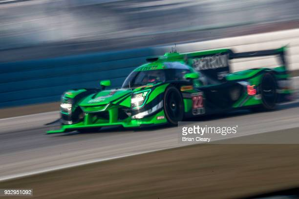 The Nissan DPi of Johannes van Overbeek Pipo Derani of Brazil and Nicolas Lapierre of France drives on the track practice for the 66th annual Mobil 1...