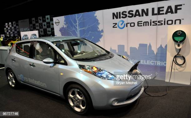 The Nissan Leaf prototype electric car on display during the press preview for the world automotive media North American International Auto Show at...