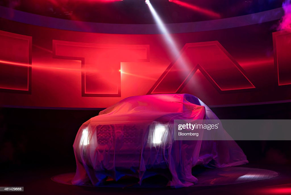 The Nissan Motor Co. 2016 Nissan Titan XD truck sits on stage before being unveiled at the 2015 North American International Auto Show (NAIAS) in Detroit, Michigan, U.S., on Monday, Jan. 12, 2015. The Nissan Titan XD design, anchored by powerful Cummins 5.0L V8 Turbo Diesel, carves out a 'new class' of full-size truck between current heavy-duty and light-duty offerings. Photographer: Daniel Acker/Bloomberg via Getty Images