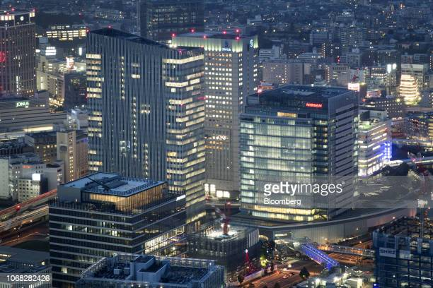 The Nissan Motor Co headquarters center right stands among buildings at dusk in Yokohama Japan on Monday Dec 3 2018 Nissan's independent board...