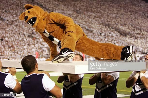 The Nittany Lion mascot of the Penn State Nittany Lions does a pushup for each point during the game against the University of Notre Dame Fighting...