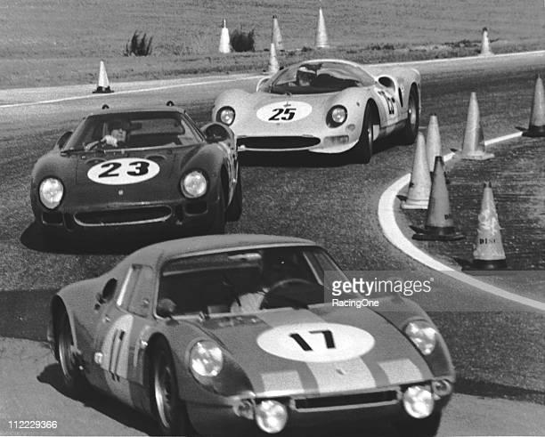 The No 17 Porsche 904 GTS of Guenther Klass / Udo Schuetz leads the Ferrari 250 LM of Mark Konig / Peter Clarke / Bob Hurt through the infield road...