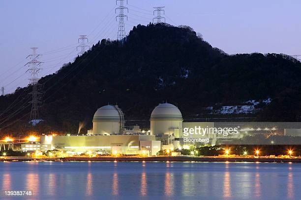 The No. 3, left, and No. 4, reactor buildings stand at Kansai Electric Power Co.'s Takahama nuclear power station at dusk in Takahama Town, Fukui...