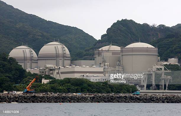 The No 4 from left No 3 No 2 and No 1 reactor buildings stand at Kansai Electric Power Co's Ohi nuclear power station in Ohi Town Fukui Prefecture...