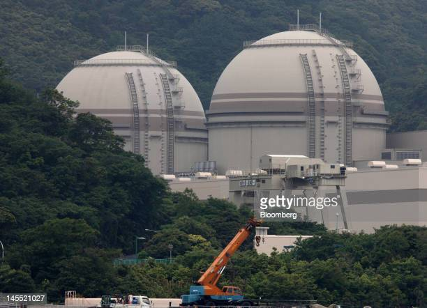 The No 4 left and No 3 reactor buildings stand at Kansai Electric Power Co's Ohi nuclear power station in Ohi Town Fukui Prefecture Japan on Friday...