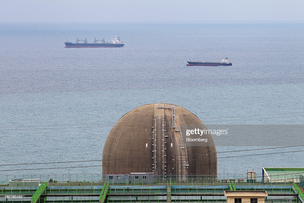 The No. 4 reactor building stands at Korea Hydro & Nuclear Power Co.'s Kori nuclear power plant as ships sail past in Busan, South Korea, on Tuesday, Feb. 5, 2013. Korea Hydro, a unit of Korea Electric Power Corp. (Kepco), operates 23 reactors in the country. Photographer: SeongJoon Cho/Bloomberg via Getty Images