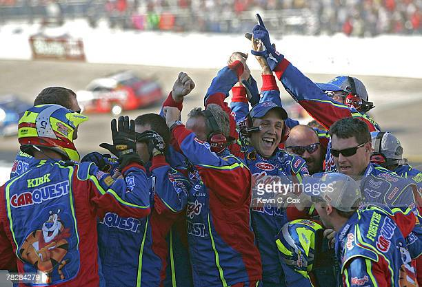 The No 5 Carquest/Kellogg's Chevrolet pit crew celebrates Kyle Busch's win in the NASCAR NEXTEL Cup Series Food City 500 Sunday March 25 at Bristol...