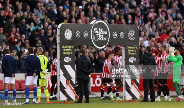 The 'No Room For Racism' handshake board is seen as both teams enter the pitch prior to the Premier League match between Brentford and Leicester City...
