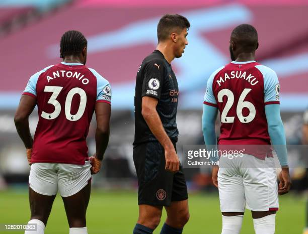 The No Room for Racism logo is seen on the sleeve of Rodrigo of Manchester City during the Premier League match between West Ham United and...