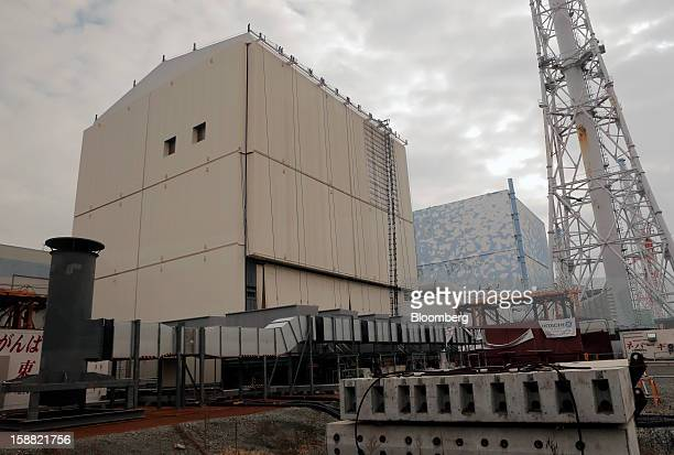 The No1 left and No 2 reactor buildings are seen through a bus window at Tokyo Electric Power Co's Fukushima DaiIchi nuclear power plant in Okuma...