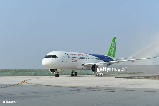 The No102 C919 passenger jet lands at Dongying Shengli Airport on July 12 2018 in Dongying Shandong Province of China Flying from the final assembly...