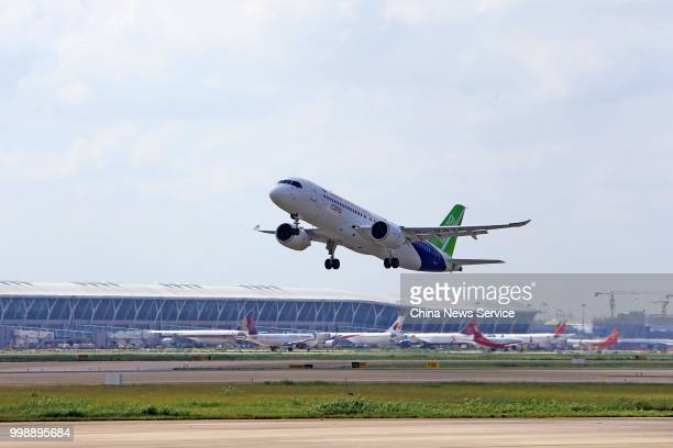 The No102 C919 passenger jet takes off at Shanghai Pudong International Airport on July 12 2018 in Shanghai China Flying from the final assembly line...