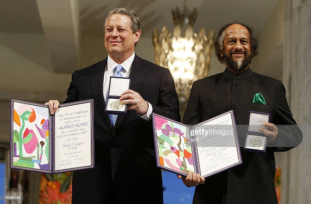 The Nobel Peace Prize laureates, Rajendra Pachauri (R) and Al Gore pose on the podium with their diplomas and gold medals during the Nobel ceremony at the City Hall in Oslo 10 December 2007. Former US vice president Al Gore and the UN's top climate panel received the 2007 Nobel Peace Prize at a ceremony in Oslo on Monday for their work to help combat global warming.