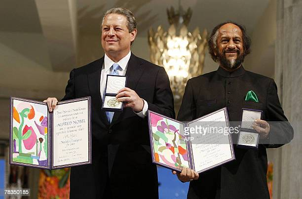 The Nobel Peace Prize laureates Rajendra Pachauri and Al Gore pose on the podium with their diplomas and gold medals during the Nobel ceremony at the...