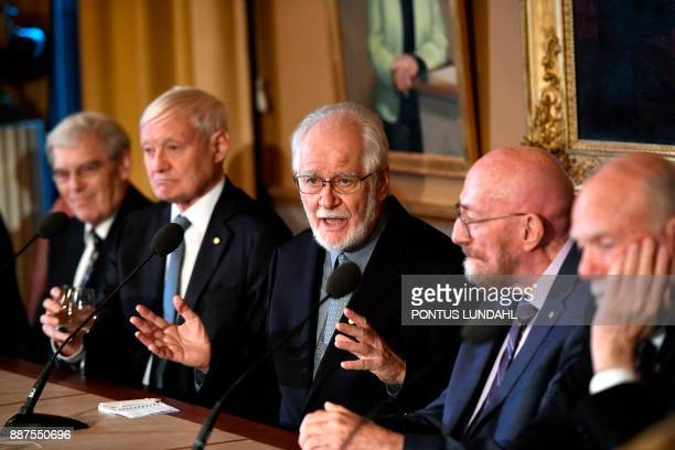 The Nobel Prize in Chemistry 2017 laureate Jacques Dubochet speaks as fellow Chemistry 2017 Nobel Prize laureates Richard Henderson from Britain and...