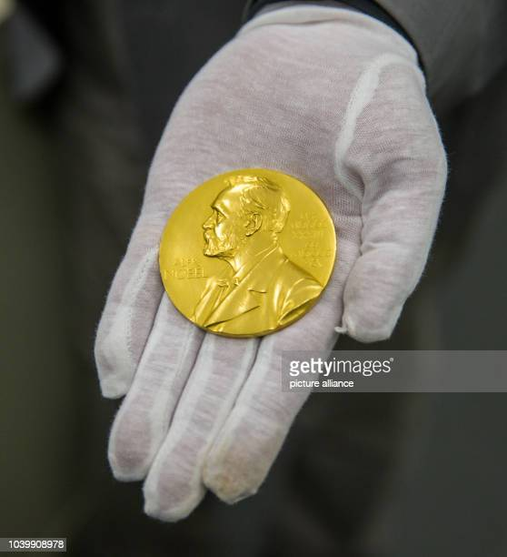 The Nobel prize medal of physicist Ferdinand Braun is presented by Wilhelm Fuessl director of the archive of the Deutsches Museum in Munich Germany...