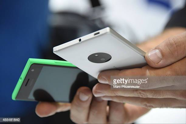 The Nokia Lumia 730 smartphones are presented at the Photokina 2014 trade fair on September 15 2014 in Cologne Germany Photokina is the world's...