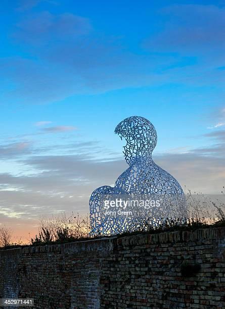 The Nomade sculpture by Spanish sculptor Juame Plense overlooks Port Vauban