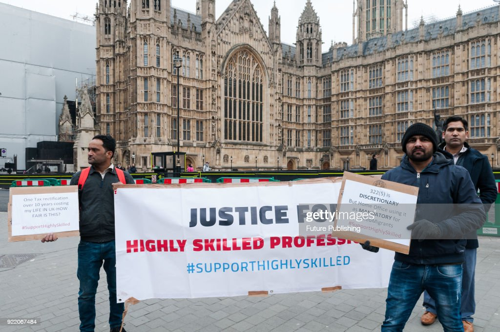 The non- EU highly skilled migrants including doctors, engineers, teachers, IT professionals as well as their families and supporters protest outside Houses of Parliament in London against the UK government's 'inhumane and discriminatory' immigration rules. Highly Skilled Migrants group which represents over 600 migrants in professional occupations has raised over £25,000 to challenge the Home Office in the courts for refusing indefinite leave to remain applications. February 21, 2018 in London, England.