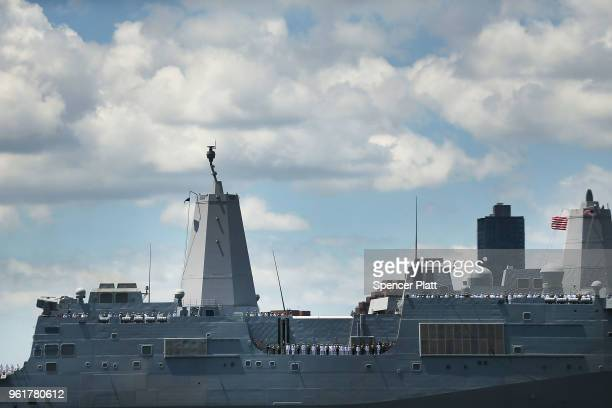 The Norfolkbased USS Arlington joins the Parade of Ships as it makes its way past the Statue of Liberty on the opening day of Fleet Week on May 23...