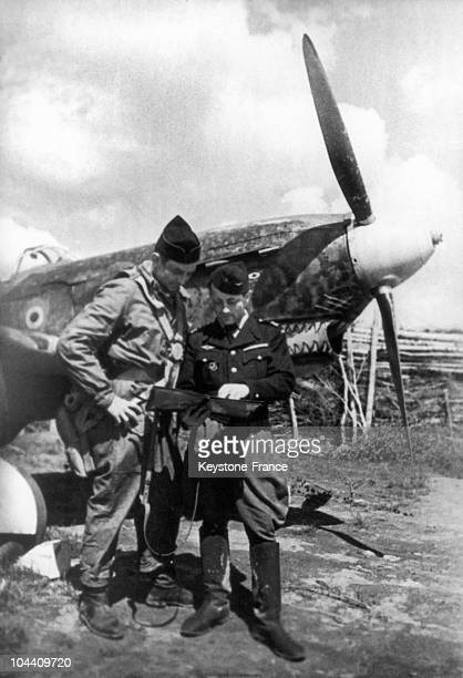 USSR The NORMANDIENIEMEN French Fighter Squadron's commander Jean TULASNE talking with Albert DURAND one of the pilots This French air formation was...