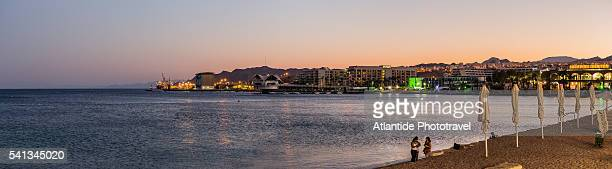 the north beach and the town at twilight - eilat stock pictures, royalty-free photos & images