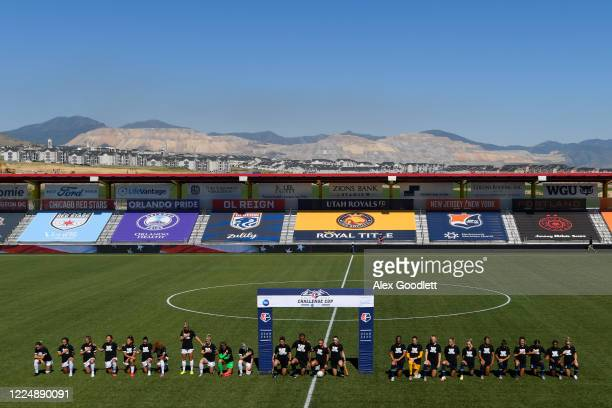 The North Carolina Courage and Chicago Red Stars take a knee during the national anthem before a game on day 5 of the NWSL Challenge Cup at Zions...