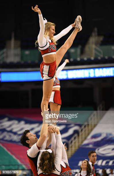 The North Carolina State Wolfpack cheerleaders perform during the ACC women's tournament game between the NC State Wolfpack and the Louisville...