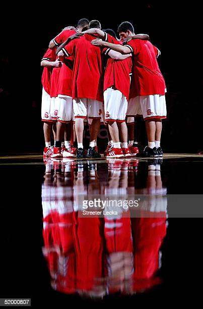 The North Carolina State Wolfpack huddle together before the start of their game against the Georgia Tech Yellow Jackets on January 16, 2005 at the...