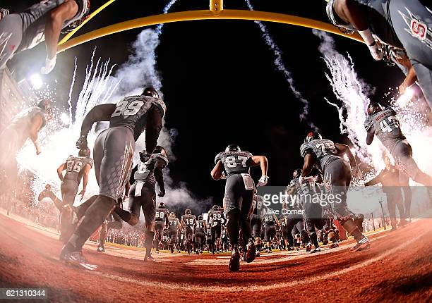 The North Carolina State Wolfpack takes the field for their football game against the Florida State Seminoles at CarterFinley Stadium on November 5...