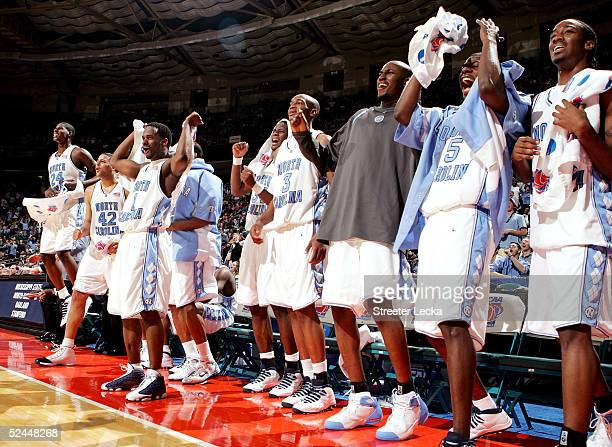 The North Carolina Tar Heel bench celebrates during their 9668 victory over the Oakland Grizzlies in their first round NCAA Tournament game at the...