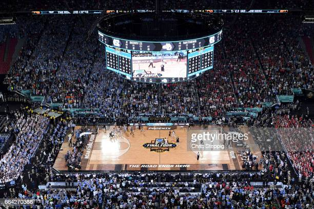 The North Carolina Tar Heels basketball team take to the court after time expires during the 2017 NCAA Photos via Getty Images Men's Final Four...