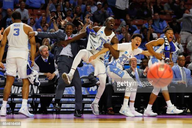 The North Carolina Tar Heels bench celebrates in the second half against the Texas Southern Tigers during the first round of the 2017 NCAA Men's...
